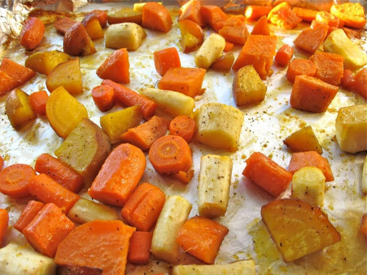 Diced root vegetables on a baking sheet.