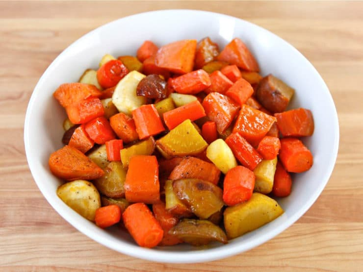 Citrus Honey Glazed Root Vegetables - A creative way to make tzimmes. Sweet root vegetables roast and caramelize in honey, orange blossom water, and zest. Pareve, Rosh Hashanah.