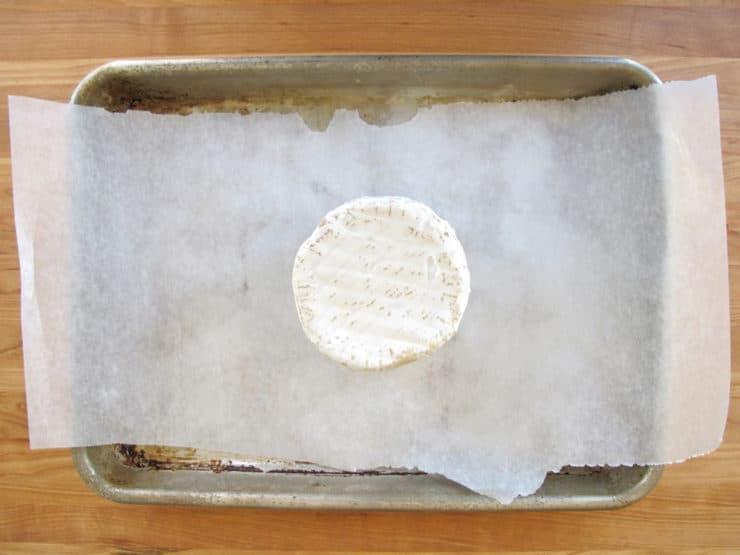 Cheese on a parchment lined baking sheet.