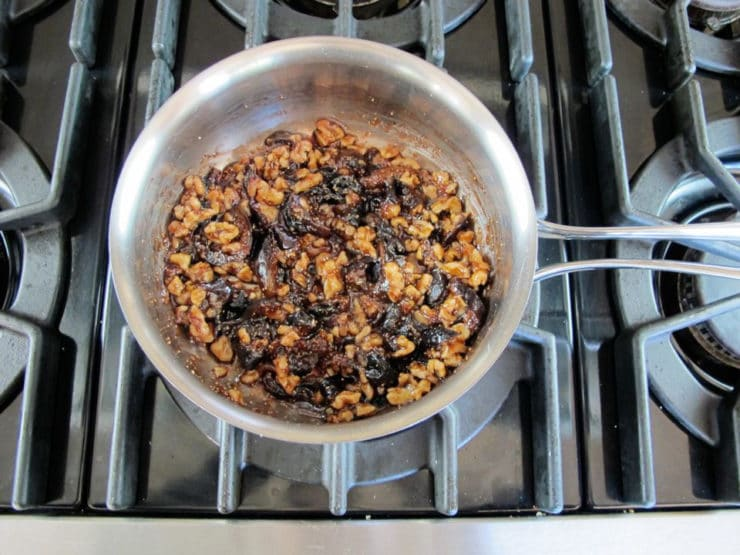 Walnuts stirred into fig syrup.