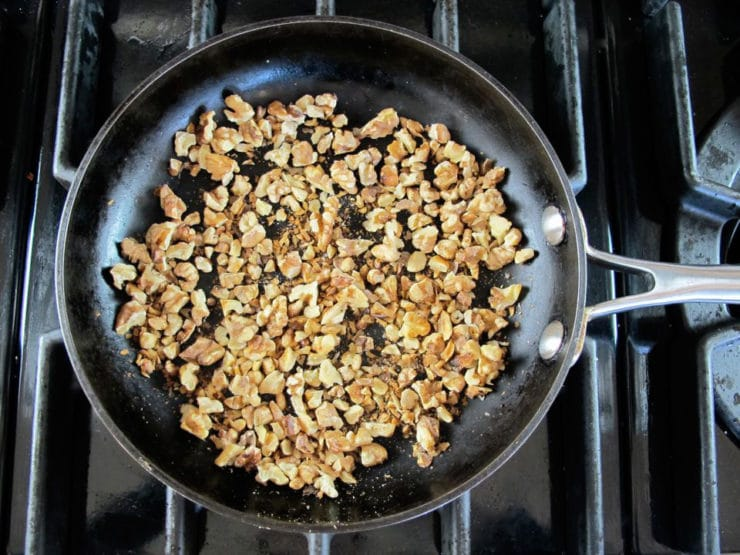 Dry toasting nuts in a skillet.
