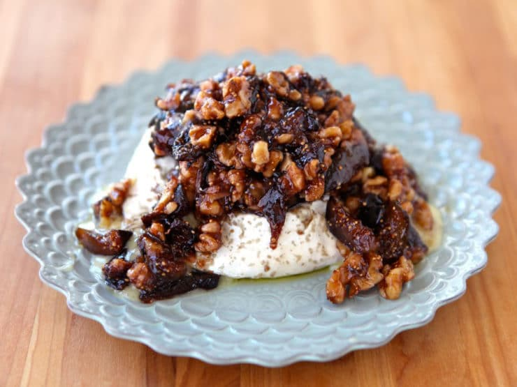 Fig & Cheese Appetizer - Farm gooey soft-ripened brie or Mt. Tam cheese topped with warm sugary fig sauce and toasted nuts.