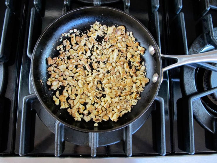 Dry toasting walnuts in a skillet.