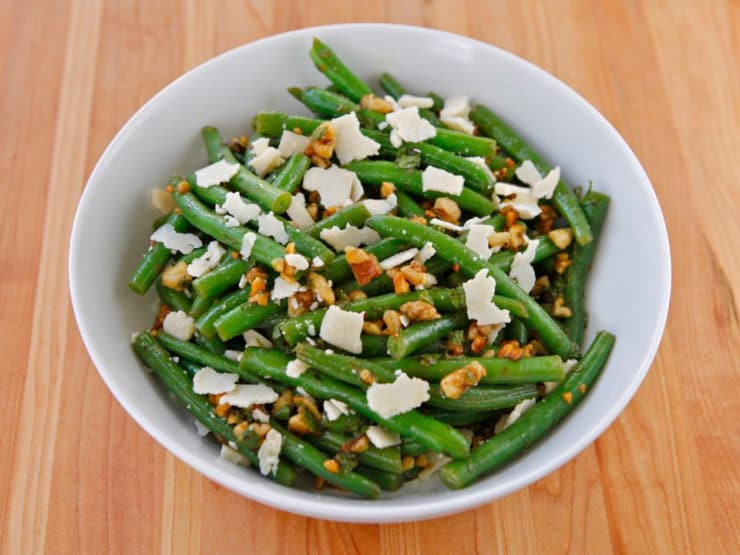 Green Bean Salad with Walnuts, Parmesan and Mint - Flavorful salad with lightly steamed green beans, roasted chopped walnuts, fresh mint, shaved parmesan, olive oil and white balsamic vinegar.