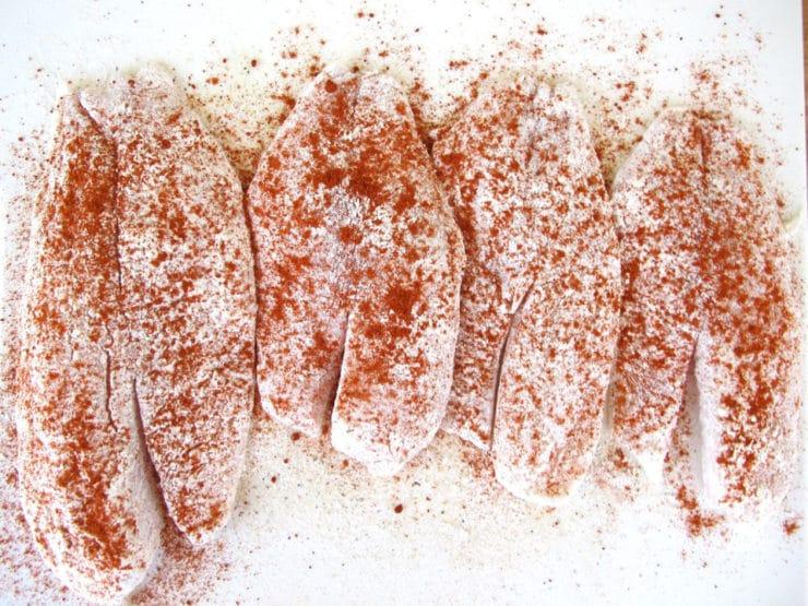 Seasoning tilapia with paprika.