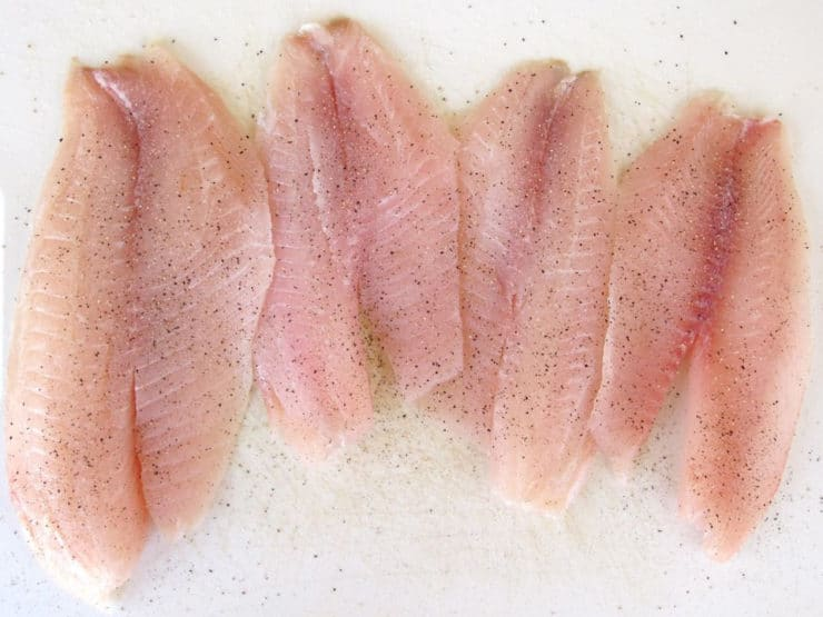 Rinsed fish fillets on paper towel.