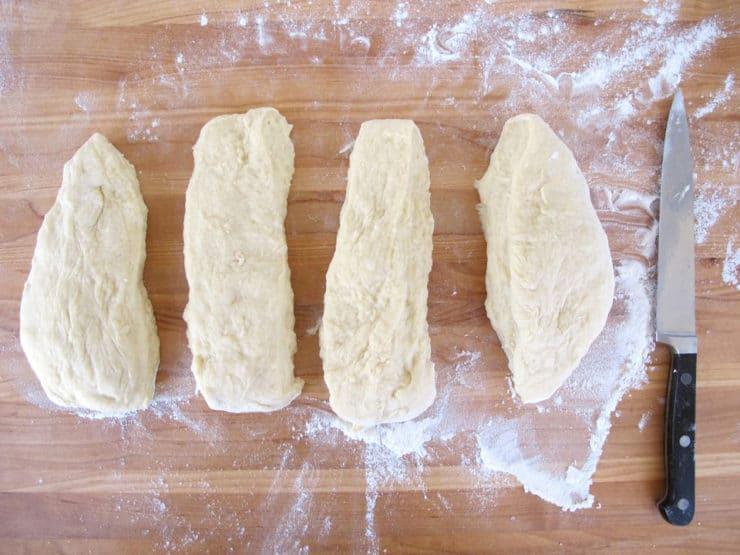 Challah dough cut into four portions.
