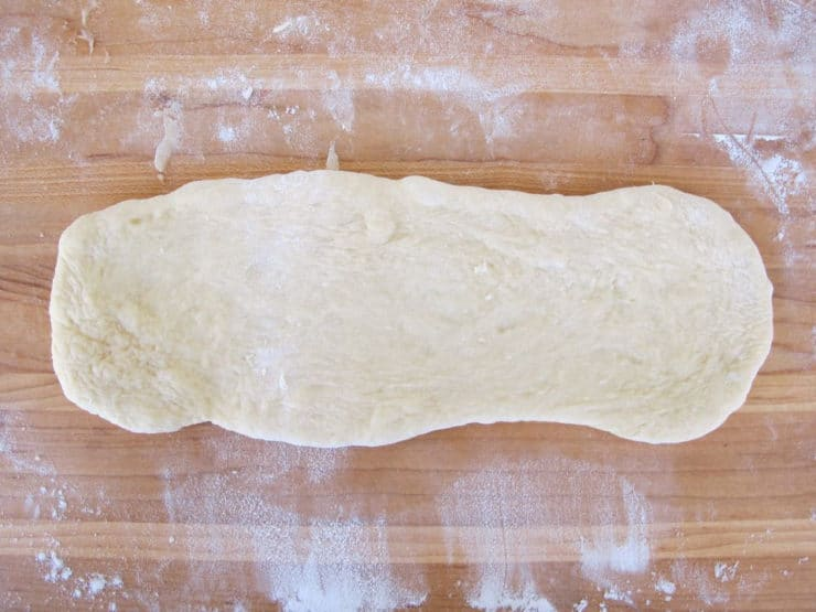 Section of challah dough rolled out.