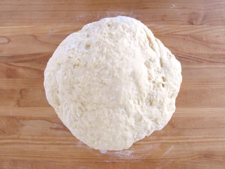 Challah dough on a floured surface.
