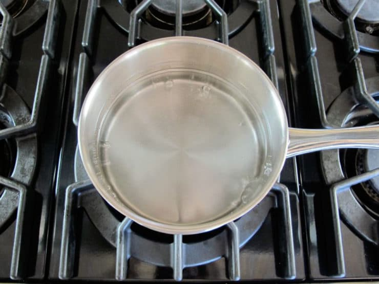 Boiling water in a saucepan.