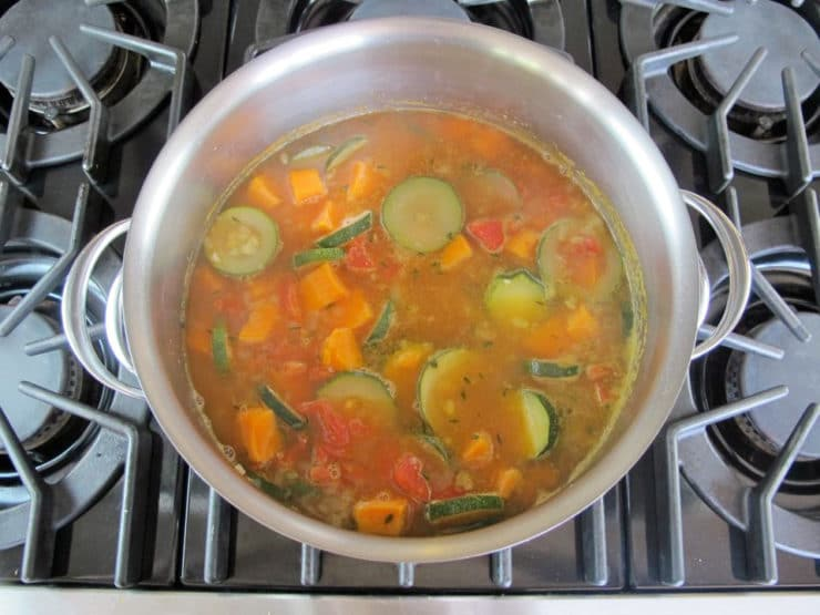 Sliced vegetables in a stockpot.