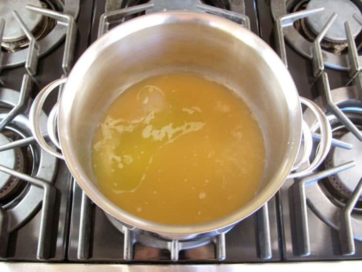 Boiling stock in a stockpot.