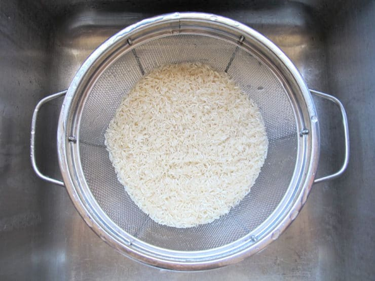 Rinsing uncooked rice.
