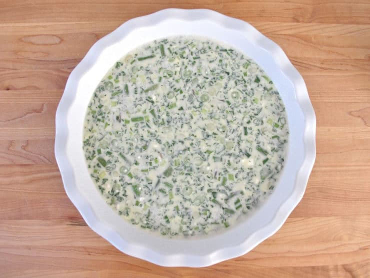 Quiche mixture in a bowl.