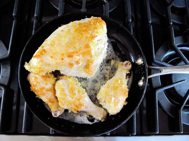 Browning chicken in a skillet.