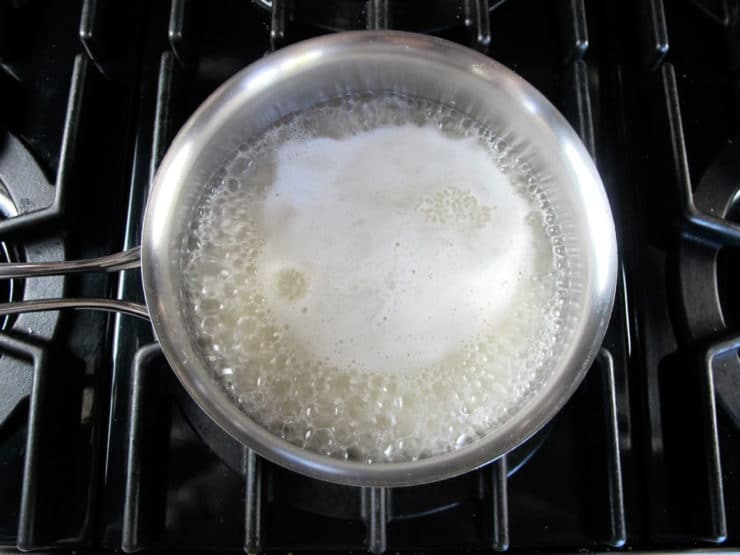 Cooking rice in a saucepan.