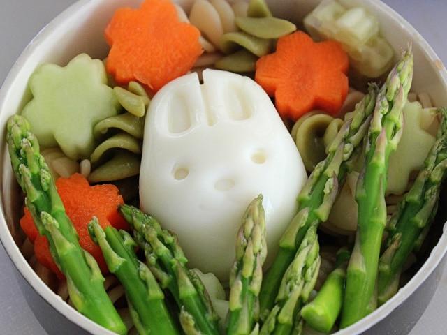 Hard boiled egg bunny in asparagus.