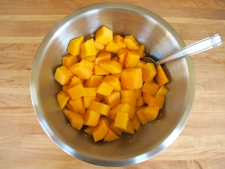 Butternut squash cubes in a mixing bowl.