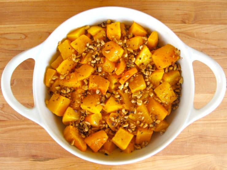 Walnuts over butternut squash in a gratin dish.