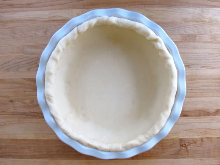 Pie dish lined with crust dough.
