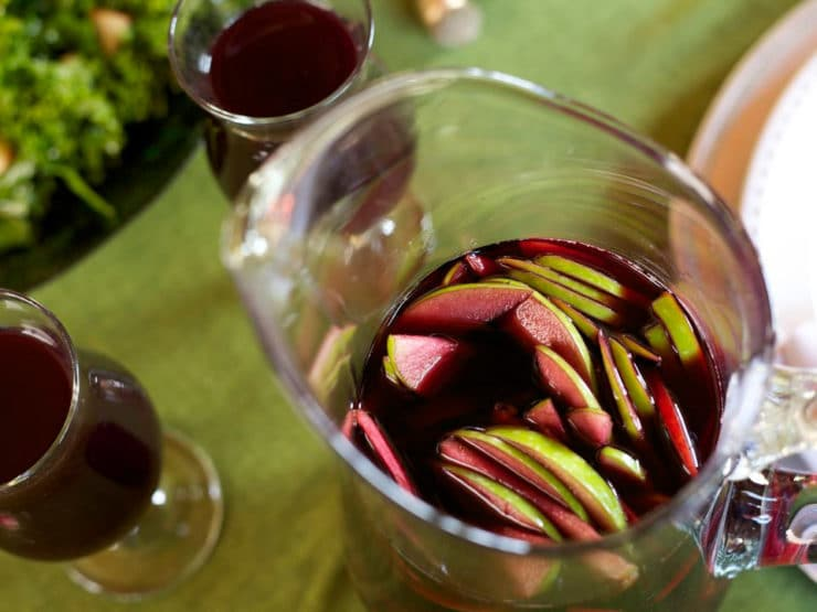 Thanksgiving Cider Sangria - A seasonal Thanksgiving holiday sangria with apple cider, red wine, harvest fruits and spices. Crisp, cold and delicious.