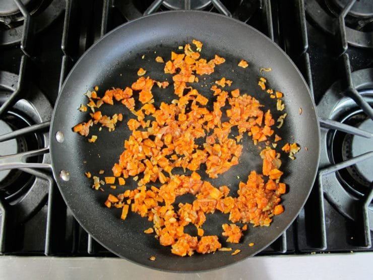 Chopped carrots in a skillet.