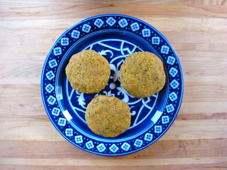 Black eyed pea patties on a plate.