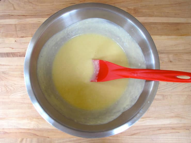 Stirring yogurt into cake batter.