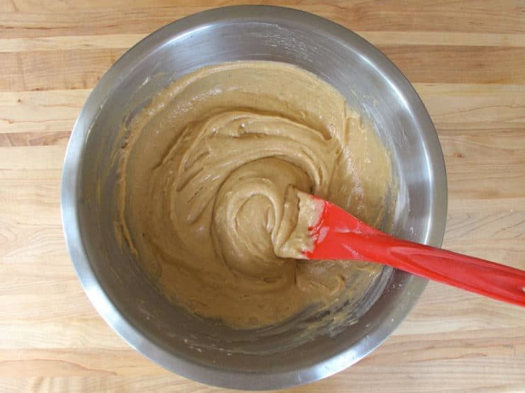 Wet and dry cake ingredients mixed in a bowl.