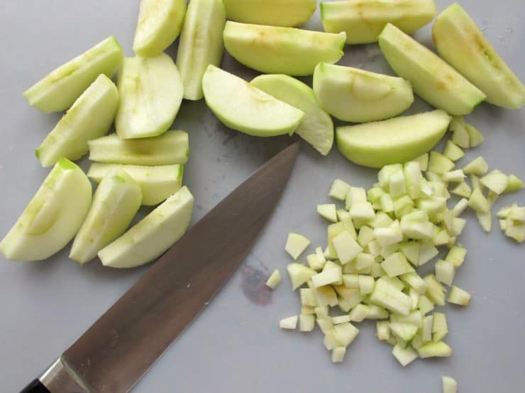 Finely diced apple on a cutting board.