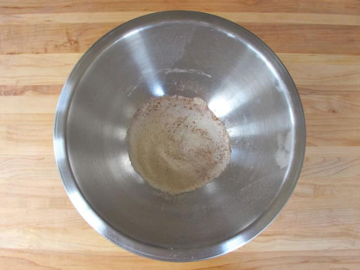 Dry ingredients sifted into a mixing bowl.