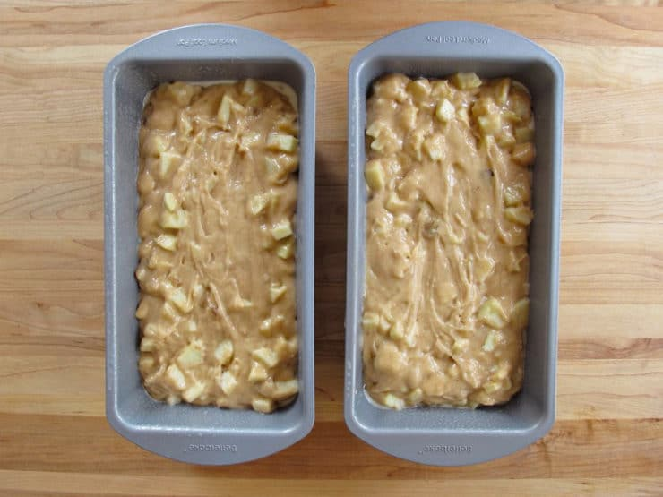 Apple cake batter in two loaf pans.