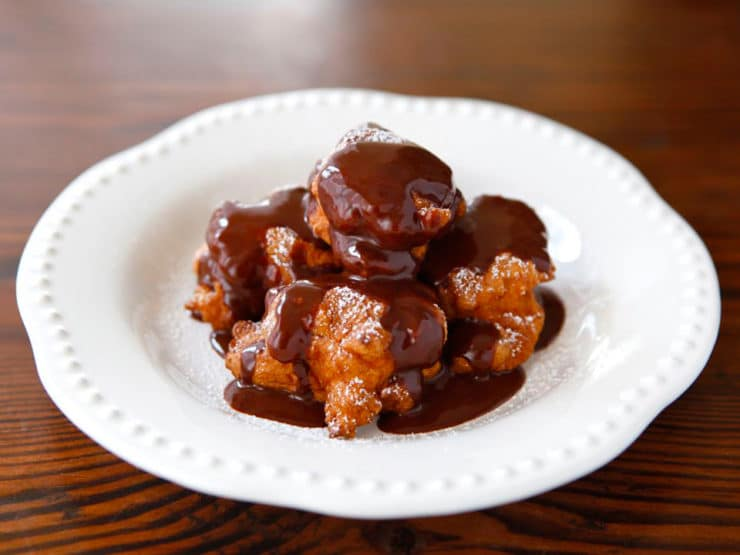 Hanukkah Bimuelo Fritters with Warm Chocolate Sauce - fried dessert fritters served with warm sweet chocolate sauce. Chanukah, holidays, Sephardic Jewish food.
