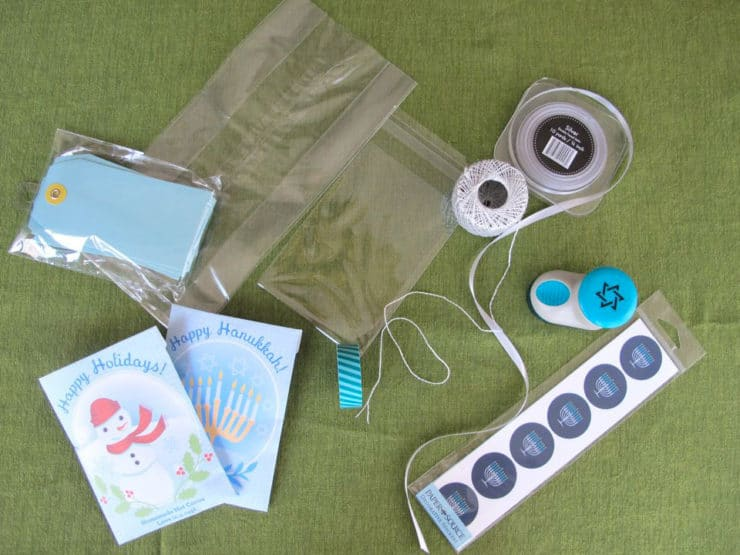 Items for assembling gift bags - cellophane bags, string, stickers, and printable hot cocoa pouches.