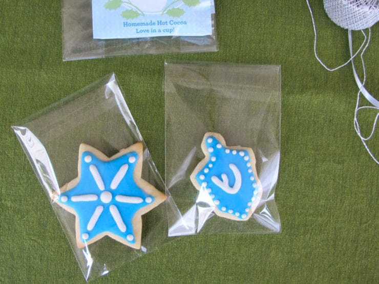 Decorated holiday sugar cookies with royal icing in cellophane bags, sealed.