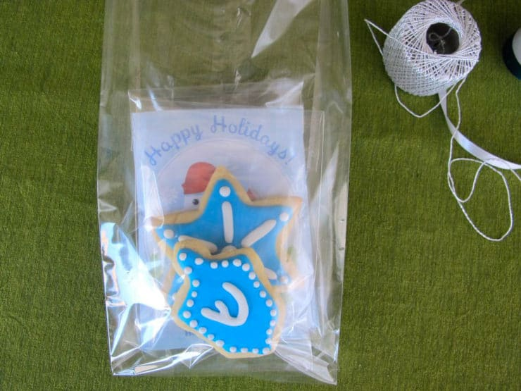 Hot cocoa pouches and sugar cookies packed in large cellophane bag.
