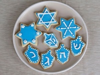 Plate of decorated iced Hanukkah holiday sugar cookies.