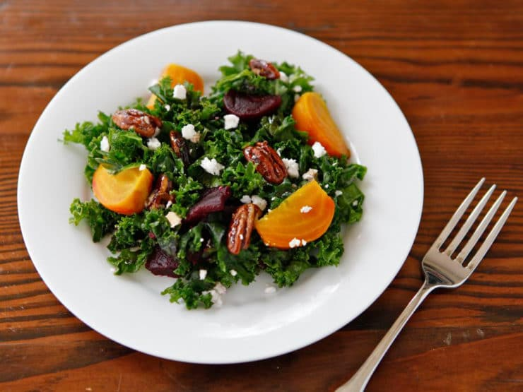 Kale and Roasted Beet Salad with Maple Balsamic Dressing - This healthy wintery salad recipe has a vegan option. Massaged kale, roasted beets, candied maple pecans, and optional feta or goat cheese.