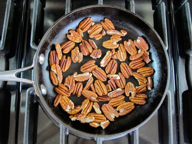 Dry toasting pecan halves in a skillet.