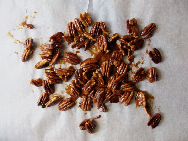Candied pecans on wax paper to dry.