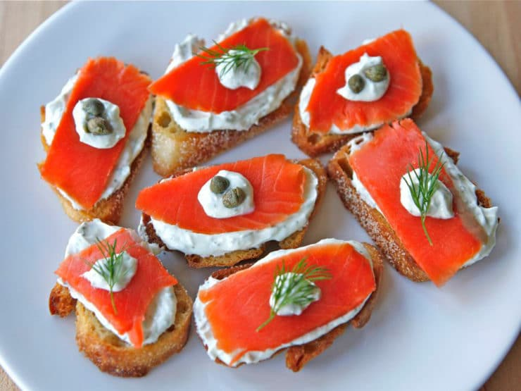 Smoked Salmon Crostini - Appetizer with a light Greek yogurt cream cheese spread, fresh dill, and capers. Kosher, Dairy, Holiday
