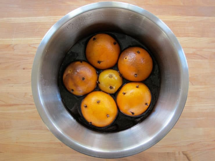 Oranges in a bowl of wine.