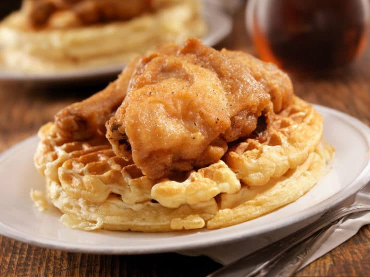 The History of Chicken and Waffles: From Medieval Times to Present - Explore the history of fried chicken, waffles, and the unlikely pairing of chicken and waffles. How this soul food favorite became popular in America.