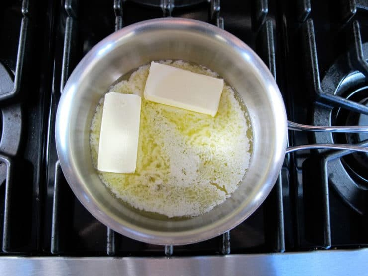 Two sticks of butter in a heavy-bottomed pan.