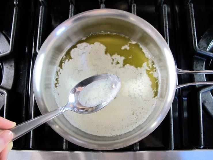 Skimming foam from melting butter.
