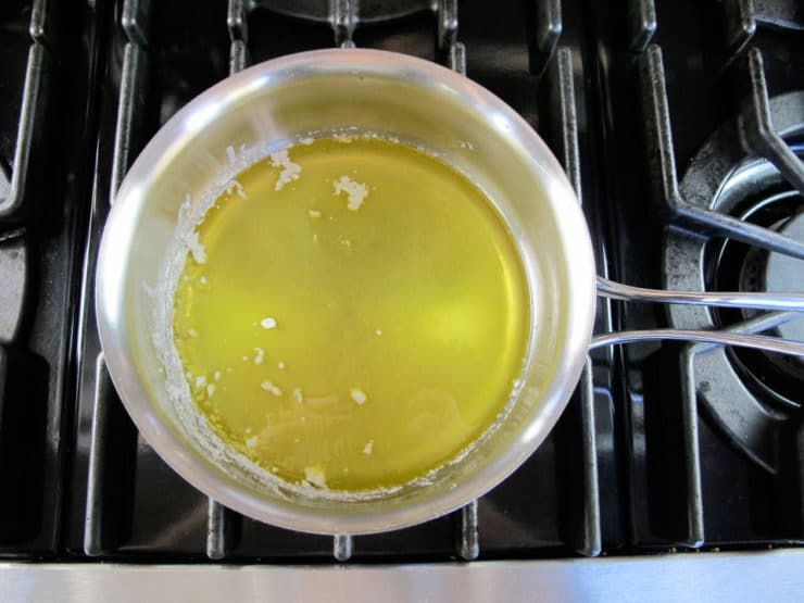 Melted butter in a saucepan.