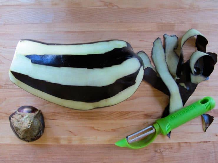 Peeling an eggplant.