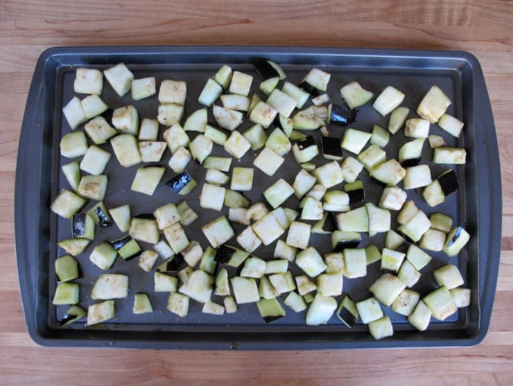 Eggplant cubes on a baking sheet.