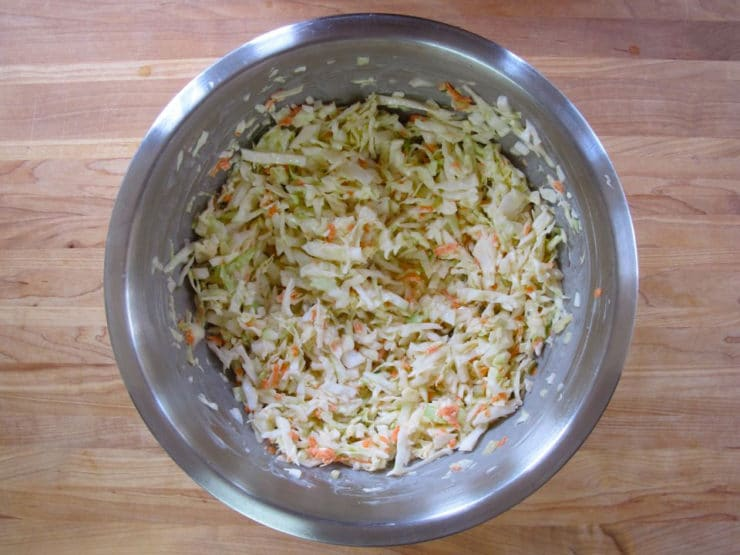 Slaw mixed up in a bowl.