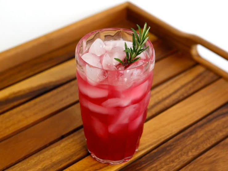 Blood Orange and Rosemary Cocktail: The Bloody Rose - Subtly sweet cocktail made with fresh blood orange juice, vodka, rosemary infused simple syrup, and soda. Kosher.